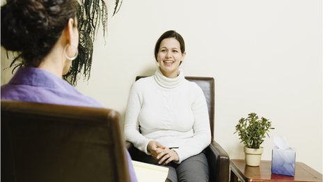 Cognitive Behavioural Therapy woman seating smiling with a doctor