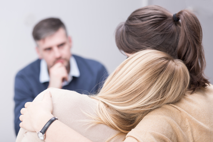 counselling family UK two women hugging